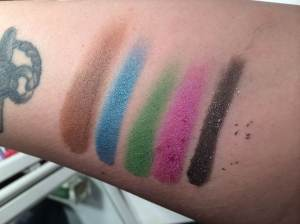 "left to right: too faced ""cocoa comet,"" urban decay ""dashiki"" ""chronic"" ""fishnet"" and ""gunmetal"""